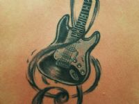 Guitar-guitarra-clave-sol-cloud-key-music-rock-tattoo-tatuaje-amor-de-madre-zamora-espalda-back